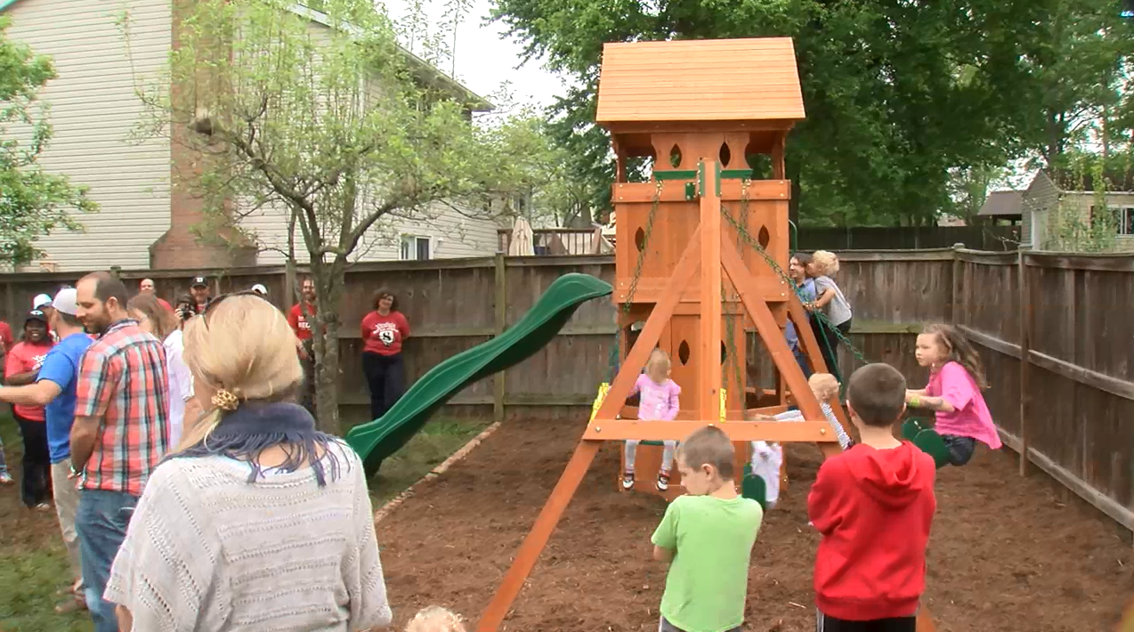 volunteers with roc solid foundation help build playsets for
