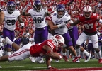 Wisconsin's Jonathan Taylor dives into the end zone for a touchdown run during the first half against Northwestern Saturday, Sept. 30, 2017, in Madison.