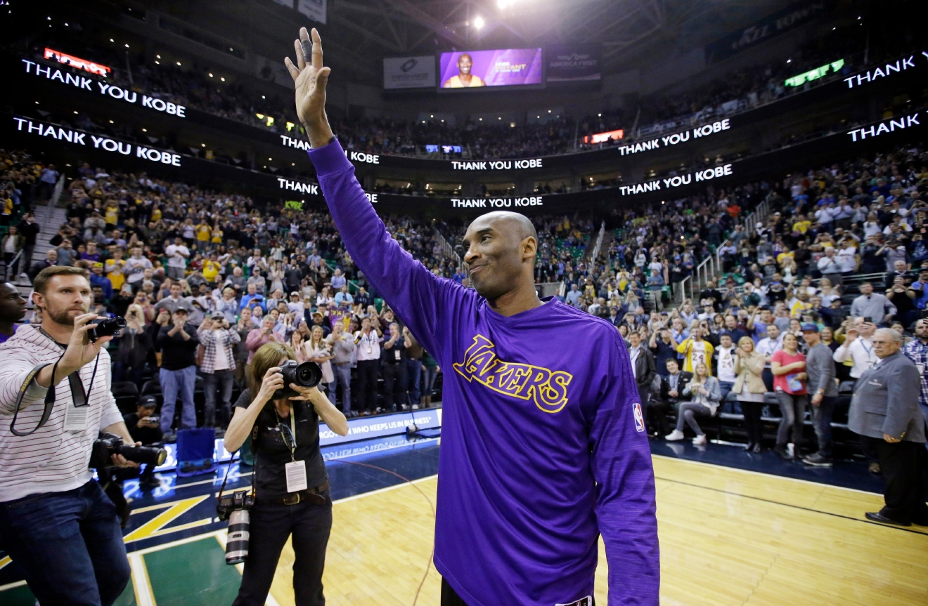 Los Angeles Lakers forward Kobe Bryant waves to the fans after his introduction before the start of the first quarter of an NBA basketball game against the Utah Jazz Monday, March 28, 2016, in Salt Lake City. (AP Photo/Rick Bowmer)