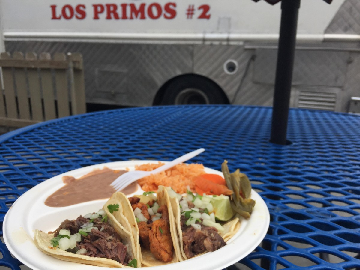 Los Primos 2's Taco Especial. For $5.50, you get three tacos, rice, and beans. These tacos are lengua, al pastor, and cabeza. (Image: Frank Guanco)