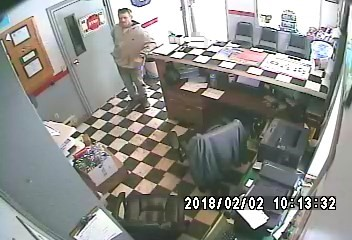 This image from a surveillance video shows the man police have said is a suspect in the theft from Schoolcraft business. (Contributed)