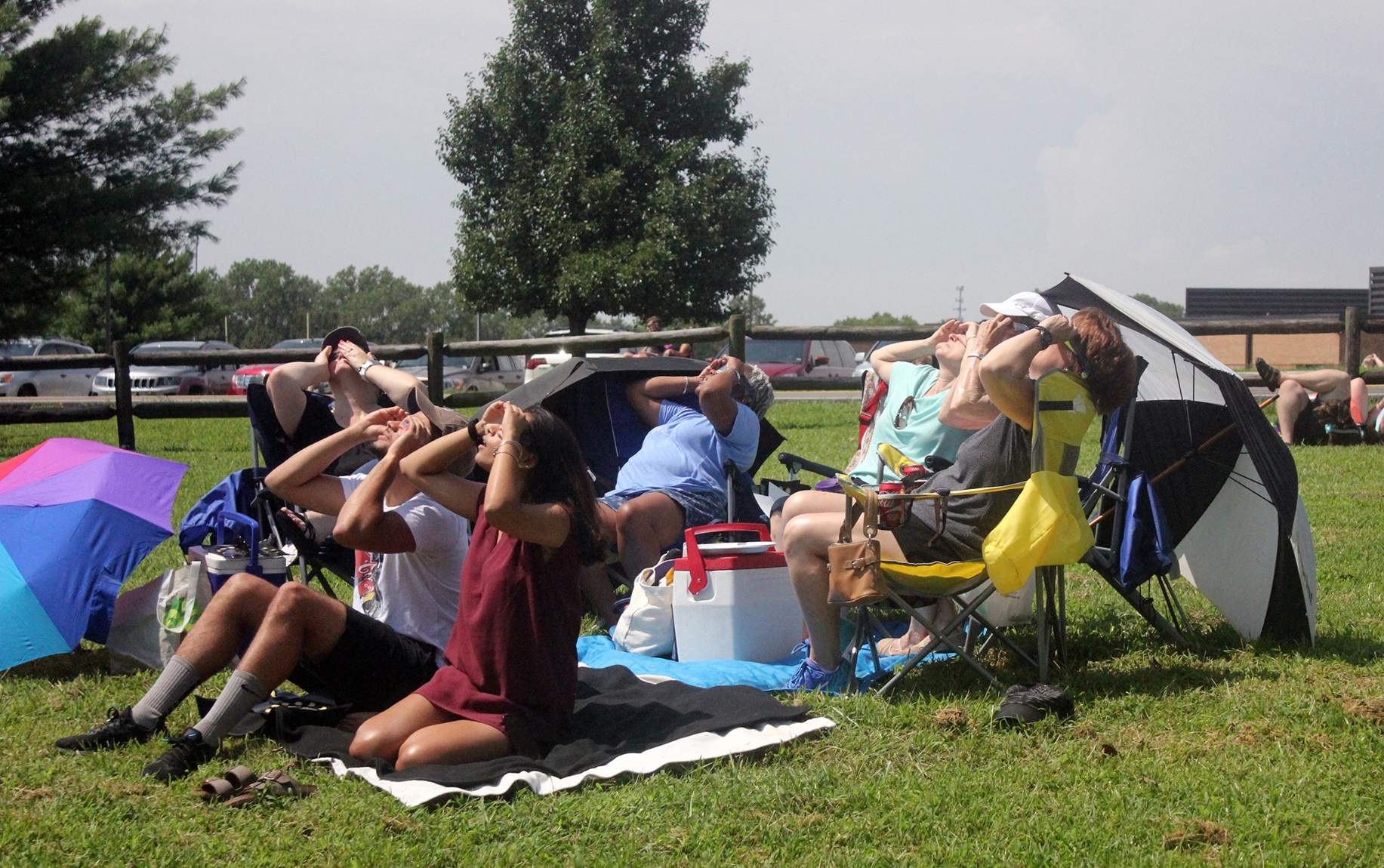 A multi-family gathering as totality approaches at George Owens Nature Park in Independence. [Mike Genet/The Examiner]