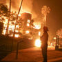 Fires blaze on 2 ends of California, killing 11 and displacing hundreds of thousands