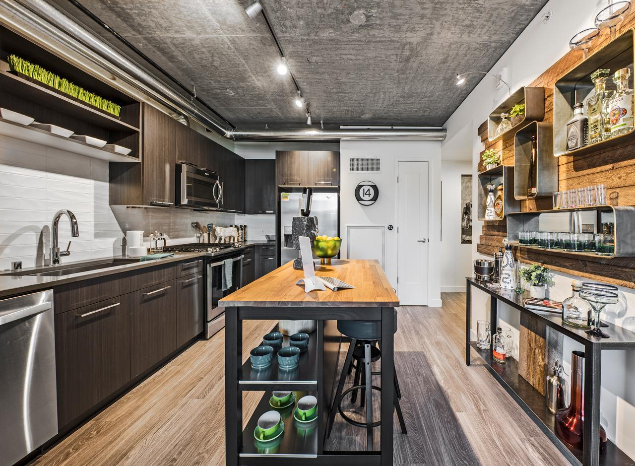 The kitchen of a one bedroom apartment at AMLI Arc<p></p>