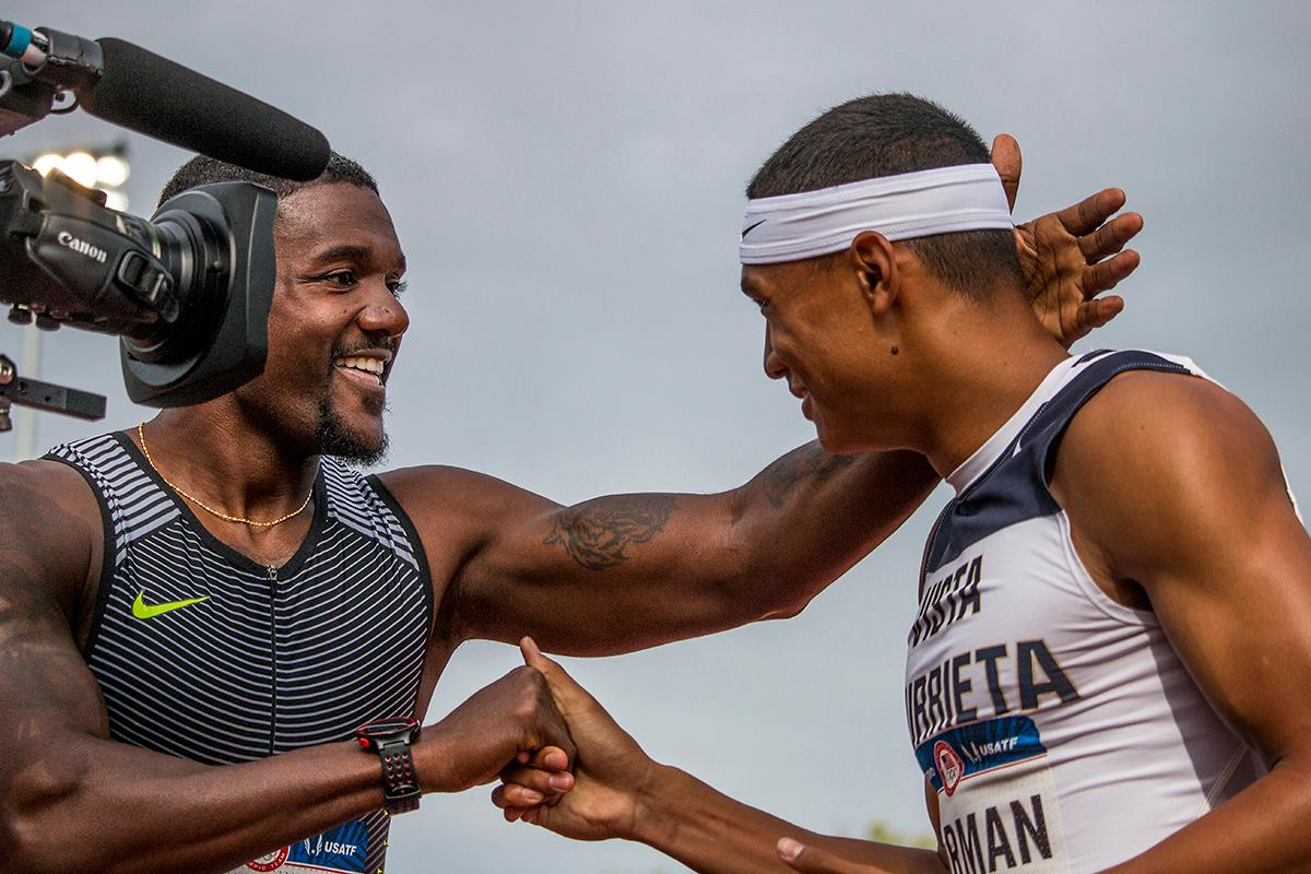 Nike�s Justin Gatlin congratulates high school athlete Michael Norman after Norman beat Gatlin in the semis of the men�s 200 meter dash. Norman ran a 20.21 second race with Gatlin in a close second place at 20.23. Day Eight of the U.S. Olympic Trials Track and Field continued on Friday at Hayward Field in Eugene, Ore. and will continue through July 10. Photo by Katie Pietzold