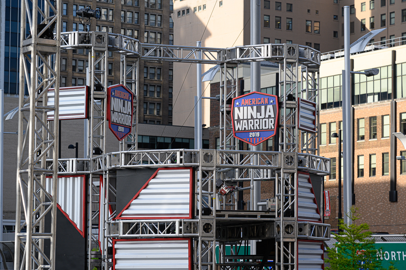 American Ninja Warrior, the NBC show that pits athletes from around the nation against challenging obstacle courses, will be filming in Cincinnati from May 24th to May 26th on Second Street between Walnut and Race Streets. The street was closed down on Monday so the obstacle course can be slowly assembled during the intervening days for the filming of the show on Friday. Tickets to watch the show live are currently sold out, but walk-ons to compete in the show are taking place at 7 PM on the lawn adjacent to the the Moerlein Lager House at The Banks. Only 20 walk-ons during that event will be chosen to compete during this weekend's taping. Also happening during the show's filming this weekend is the annual Taste of Cincinnati street food event just two blocks northeast of the American Ninja Warrior set. / Image: Phil Armstrong // Published: 5.21.19