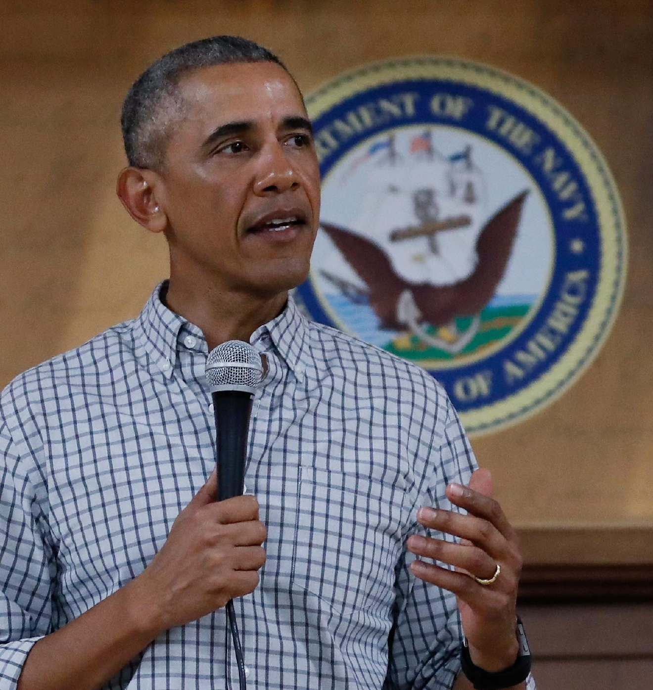 President Barack Obama speaks during an event to thank service members and their families at Marine Corps Base Hawaii in Kaneohe Bay, Hawaii, Sunday, Dec. 25, 2016. (AP Photo/Carolyn Kaster)