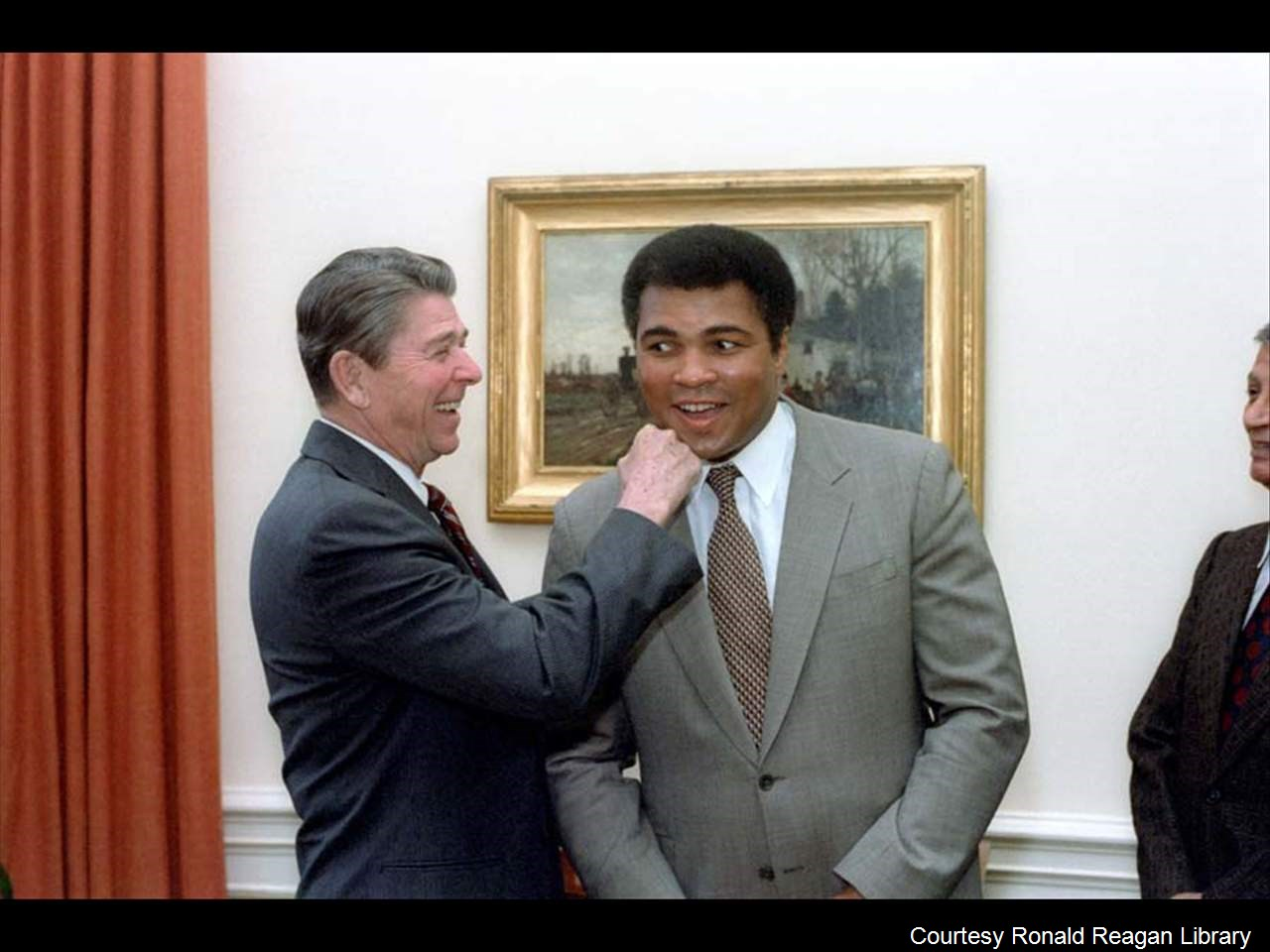 "Muhammad Ali was admitted to the hospital with a respiratory issue according to his rep who confirmed Thursday, June 2, 2016. (President Reagan ""punching"" Muhammad Ali in the oval office, Photo Date: 1/24/83 - Courtesy Ronald Reagan Library)"