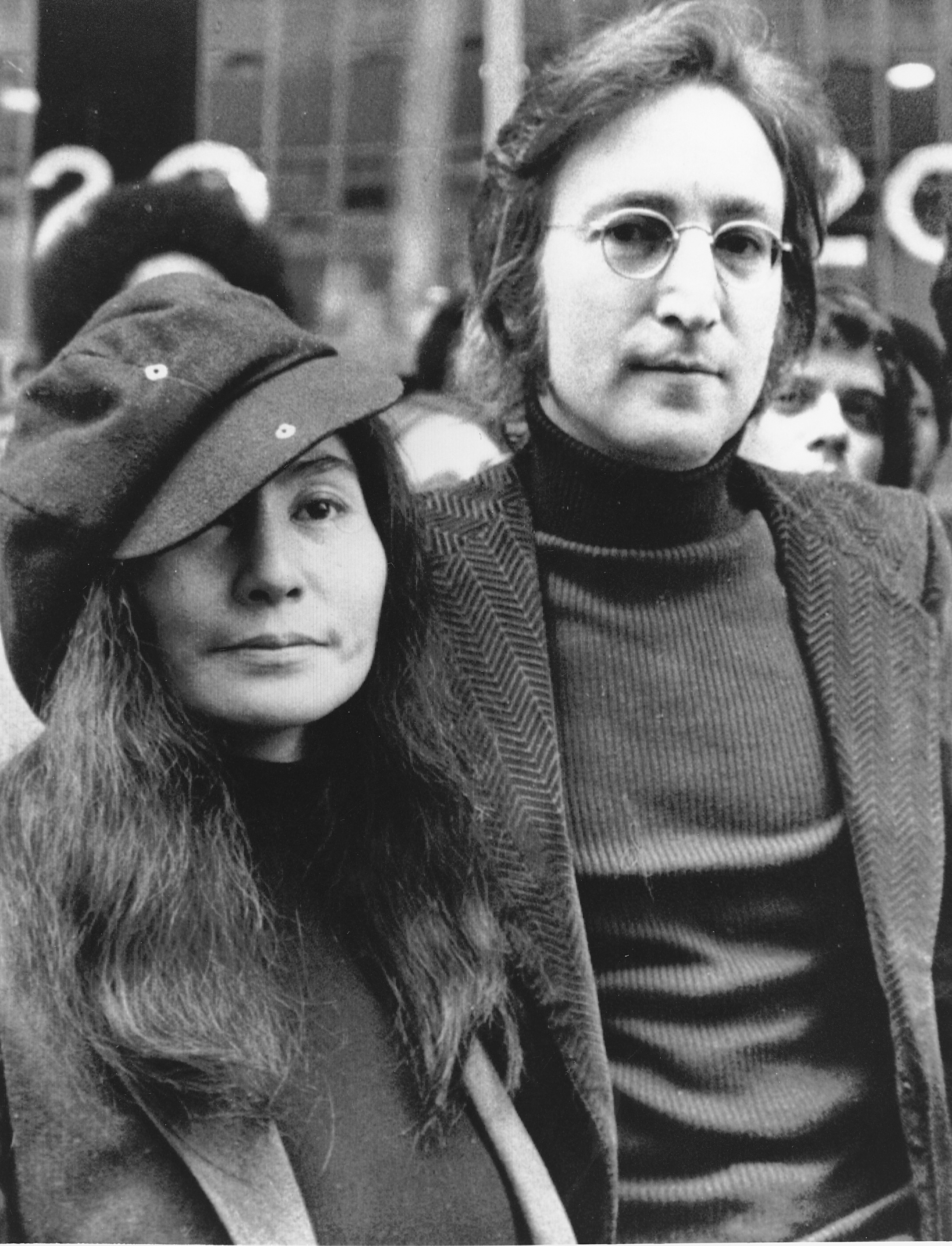 FILE - In this file photo dated April 18, 1972, John Lennon, right, and Yoko Ono, left, are seen outside the U.S. Immigration offices in New York City, USA. German police said Monday, Nov. 20, 2017 they have arrested a man suspected of handling stolen objects from the estate of John Lennon, including diaries which were stolen from Lennon's widow, Yoko Ono, in New York in 2006. (AP Photo, File)