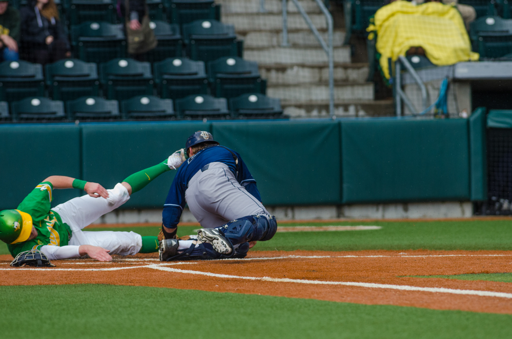 Alex Guenette (5) tags David Peterson (3) as he slides into home. In the second of the three game series, the Ducks beat the UC Irvine Anteaters 6-3. Photo by Levi Gittleman, Oregon News Lab