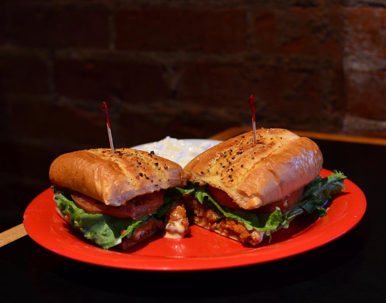 Buffalo Chicken Sandwich: spicy chicken tenders, lettuce, tomato, and ranch dressing served on a seasoned hoagie bun / Image: Leah Zipperstein, Cincinnati Refined // Published: 12.7.17