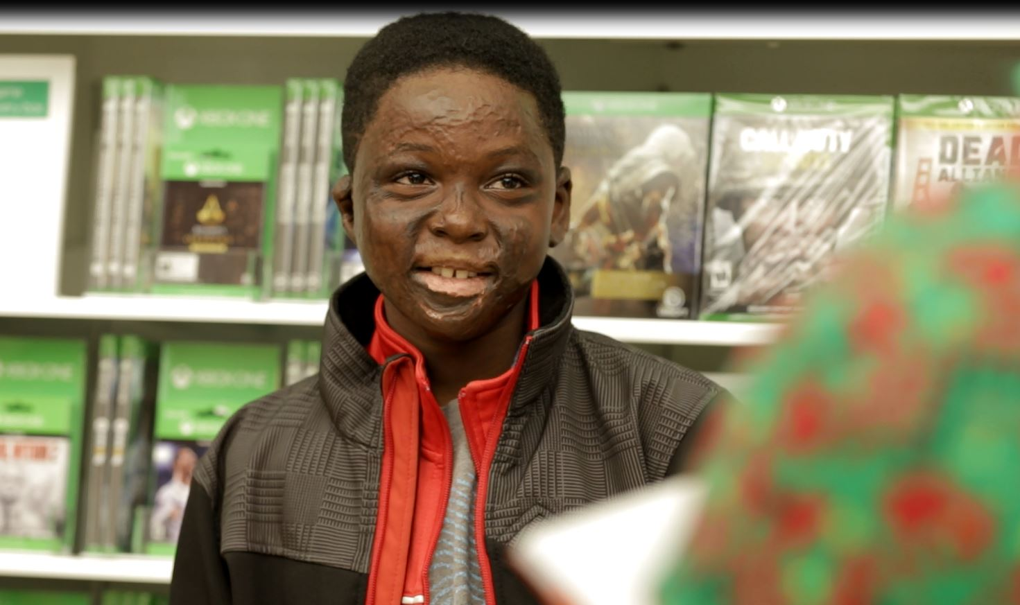 Elijah Anderson picks out games and other devices at the Microsoft Store in Portland. (Courtesy of Microsoft)<p></p>