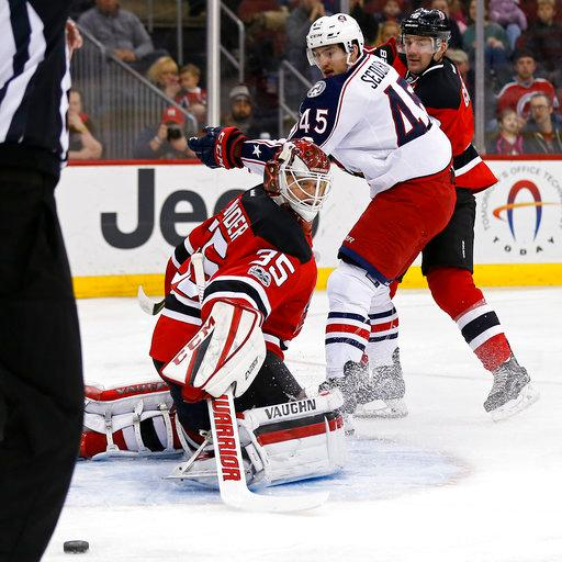 New Jersey Devils defenseman Andy Greene, far right, is called for hooking on Columbus Blue Jackets center Lukas Sedlak (45) in front of Devils goalie Cory Schneider (35) during the first period of an NHL hockey game, Sunday, March 19, 2017, in Newark, N.J. (AP Photo/Adam Hunger)