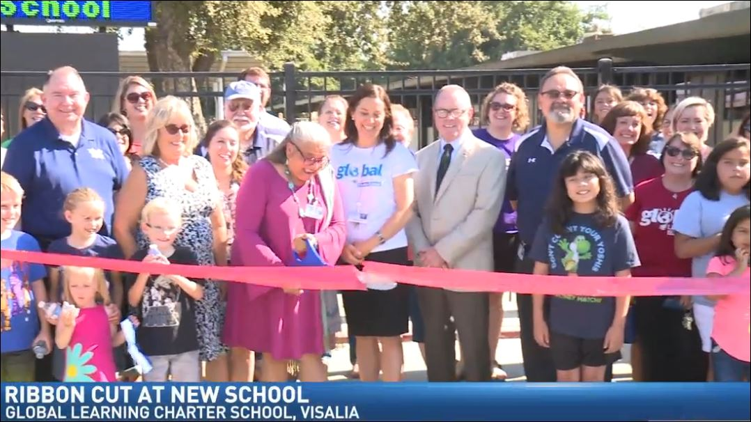Students helped teachers and staff cut the ribbon to the new Global Learning Charter School on Tuesday.