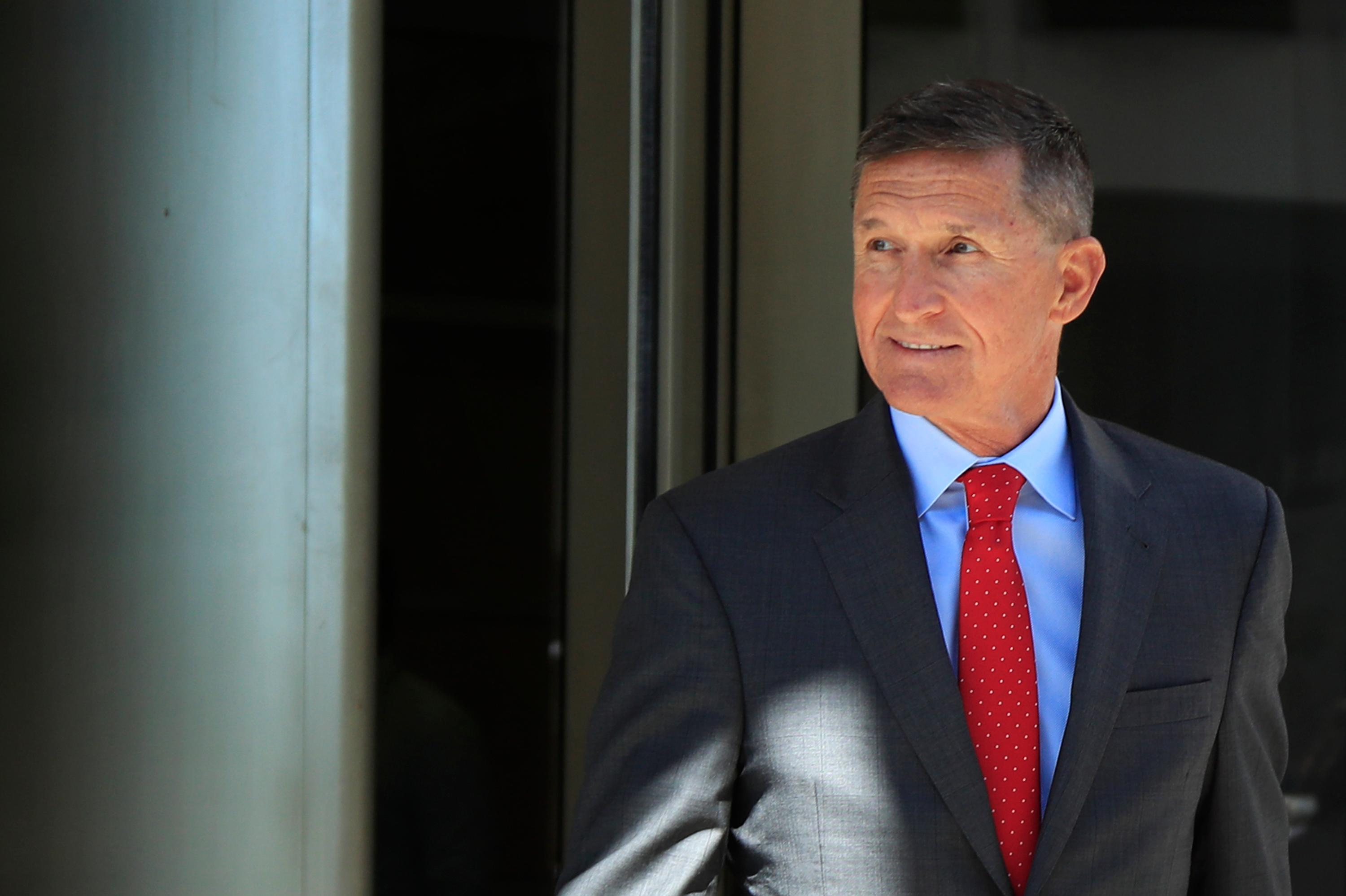 FILE - In this July 10, 2018, file photo, former Trump national security adviser Michael Flynn leaves the federal courthouse in Washington, following a status hearing.{ } (AP Photo/Manuel Balce Ceneta, File)