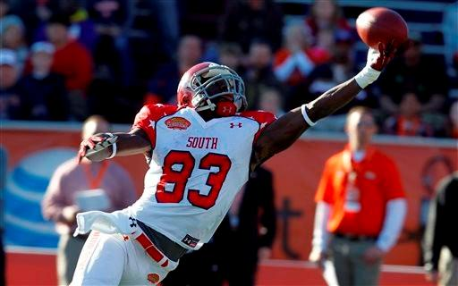 South receiver Kevin Norwood, of Alabama, tries to pull in a pass during the first half of the Senior Bowl NCAA college football game against North on Saturday, Jan. 25, 2014, in Mobile, Ala.