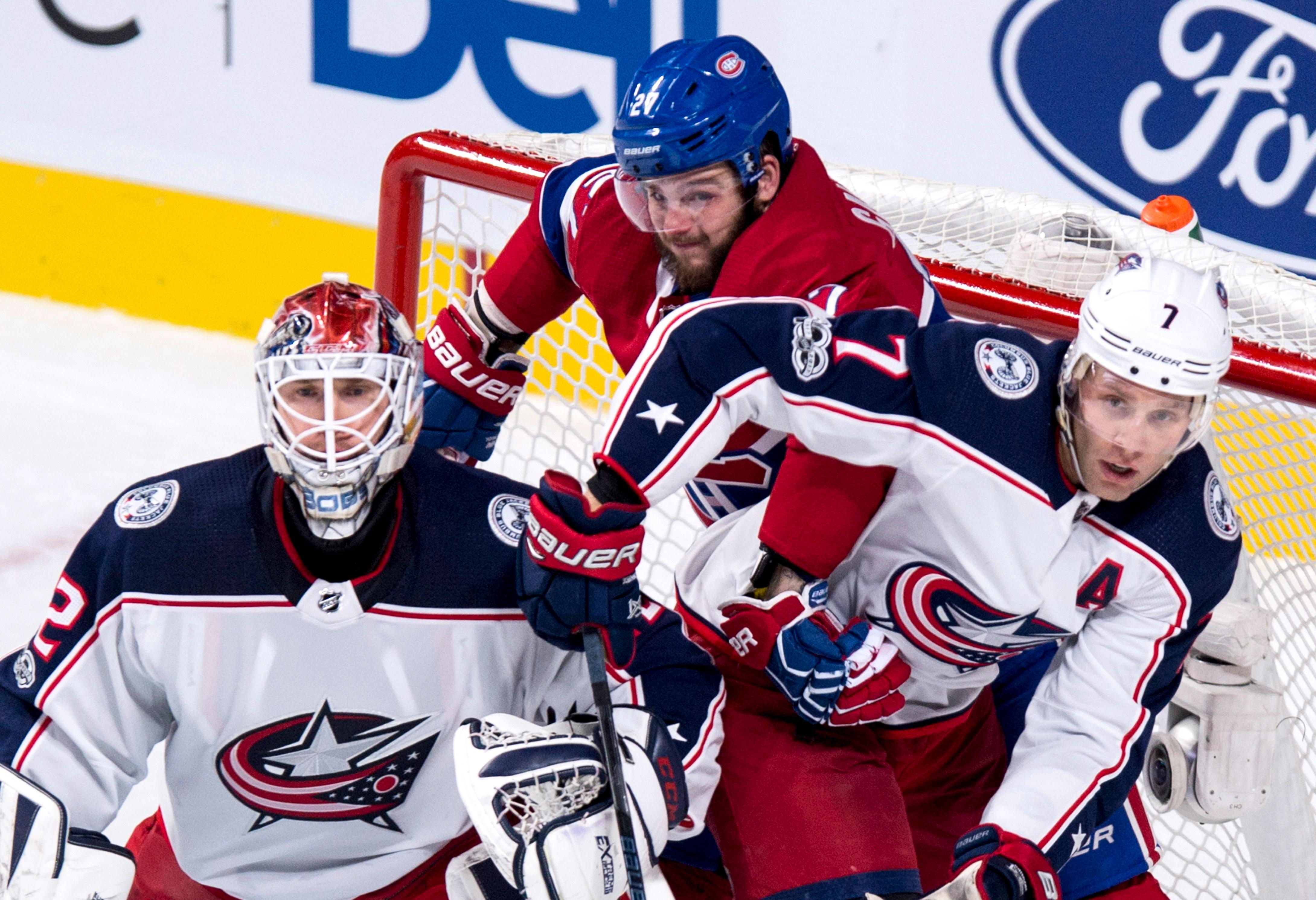 Montreal Canadiens' Alex Galchenyuk gets caught behind Columbus Blue Jackets goalie Sergei Bobrovsky and defenseman Jack Johnson during the second period of an NHL hockey game Tuesday, Nov. 14, 2017, in Montreal. (Paul Chiasson/The Canadian Press via AP)