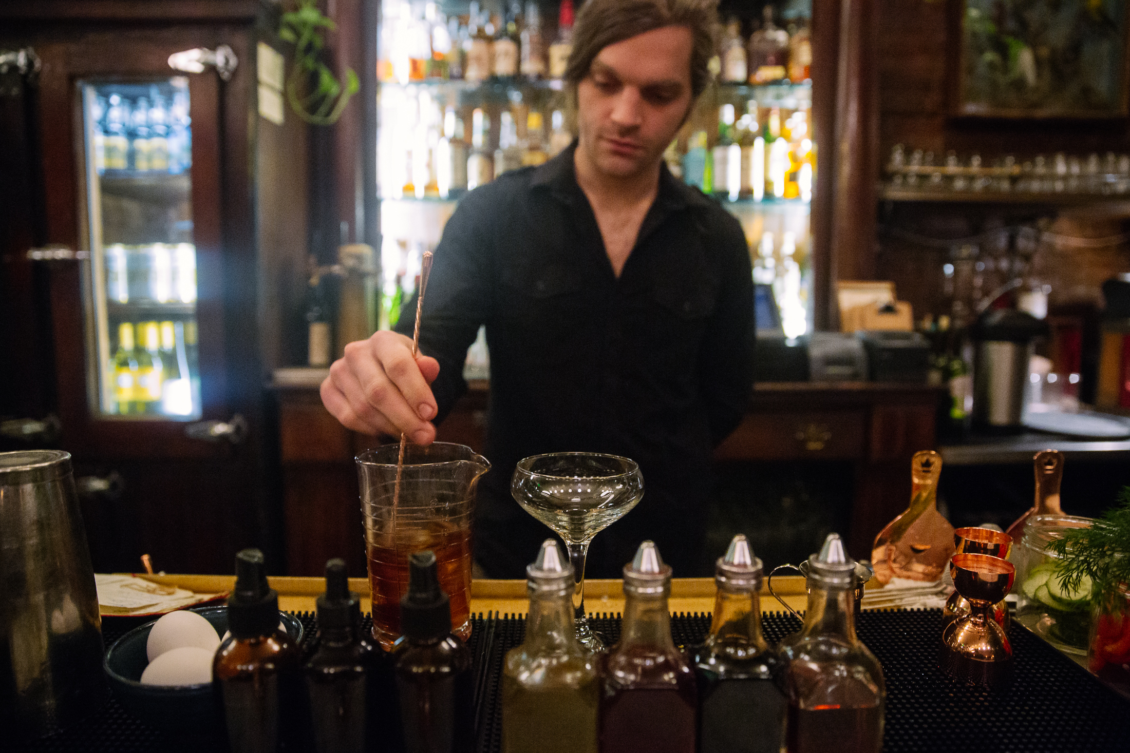 We turned to the pros at Percy's in Ballard - specifically, bar manager Bode Craig - for his take on go-to winter cocktails to help you shake off the chill. (Image: Joshua Lewis / Seattle Refined)