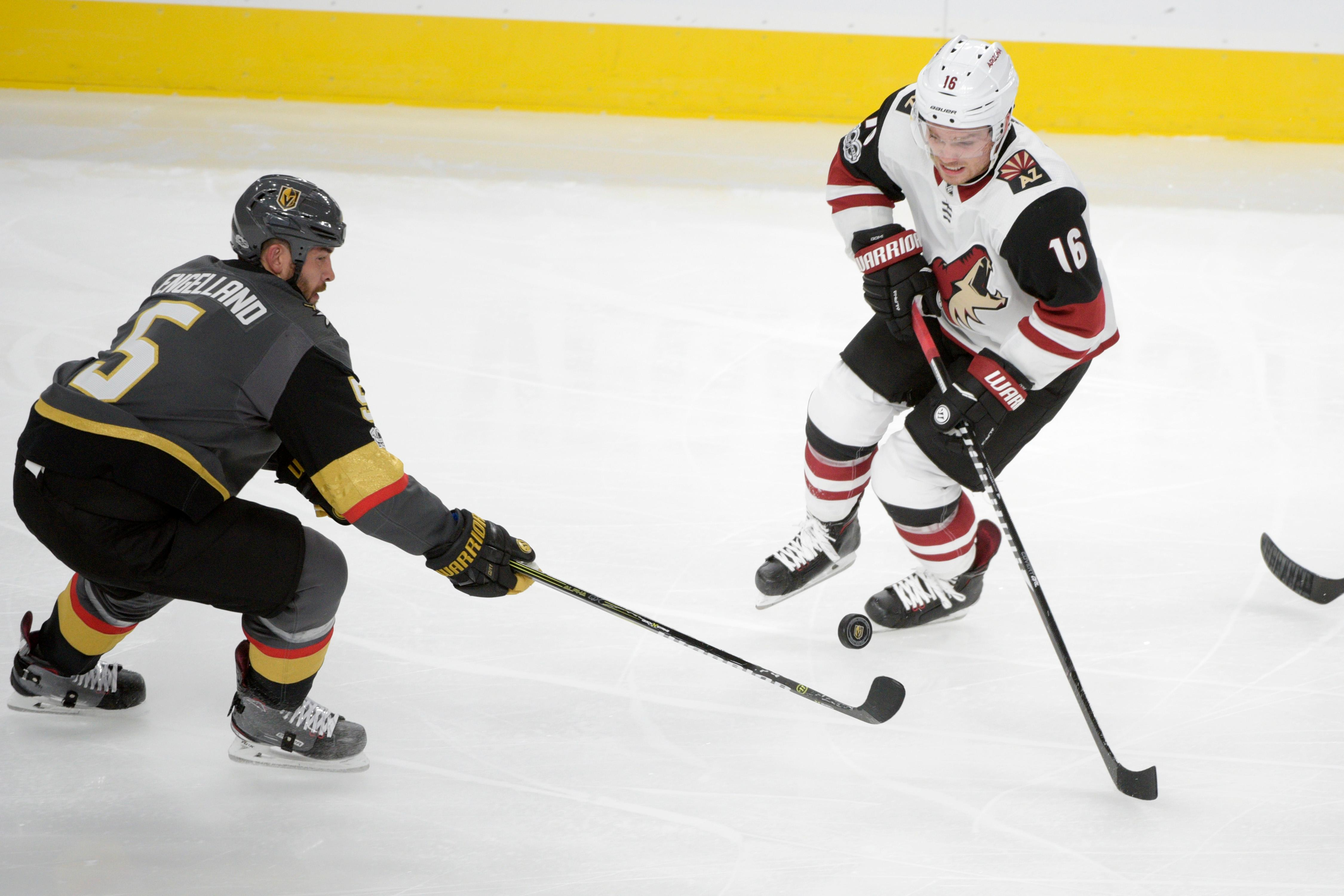 Vegas Golden Knights defenseman Deryk Engelland (5) passes the puck past Arizona Coyotes left wing Max Domi (16) during the Knights home opener Tuesday, Oct. 10, 2017, at the T-Mobile Arena. The Knights won 5-2 to extend their winning streak to 3-0. CREDIT: Sam Morris/Las Vegas News Bureau