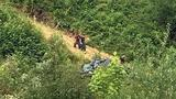 Young girl dead after car drives over embankment in Renton