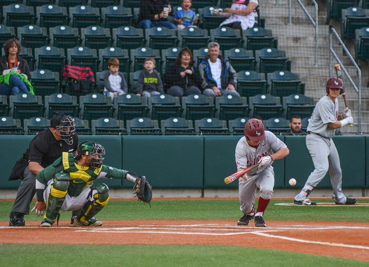 Lions infielder Spencer Erdman (#24) attempts to bunt the ball into play. On Wednesday night the Ducks fell to the Loyola Marymount Lions 4-0 at PK Park. Photo by Jacob Smith, Oregon News Lab