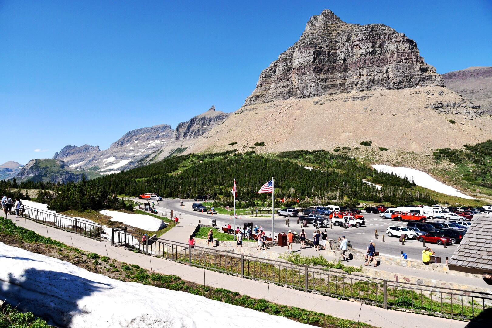 In mid-July, many of Logan Pass's trails were still snow covered. Logan Pass is the highest elevation  reachable by car in the park at 6,646 ft  and hosts a large visitor center. (Image: Rebecca Mongrain/Seattle Refined)