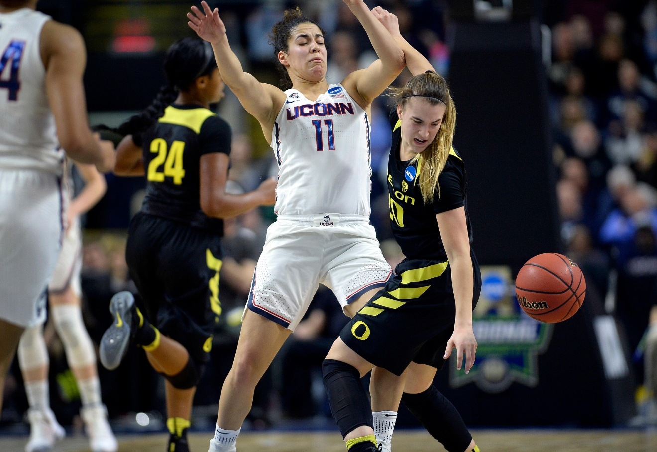 Oregon's Sabrina Ionescu, right, tries to gather the ball after running into the defense by Connecticut's Kia Nurse during the first half of a regional final game in the NCAA women's college basketball tournament, Monday, March 27, 2017, in Bridgeport, Conn. (AP Photo/Jessica Hill)
