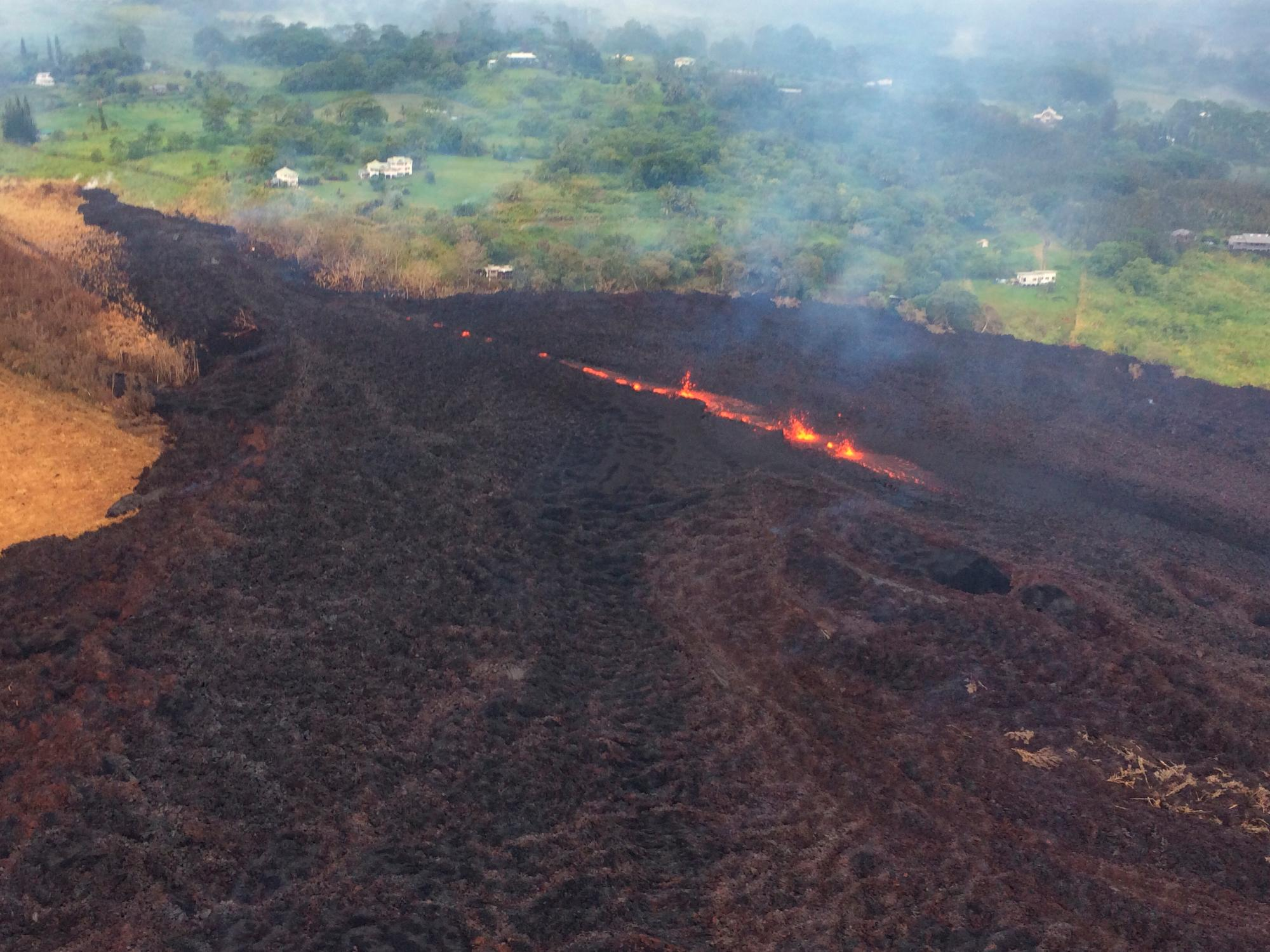 This Thursday, May 17, 2018, aerial image released by the U.S. Geological Survey, shows Fissure 17 at about 07:00 a.m. HST., in Pahoa, Hawaii. The HVO field crew reported that the spattering height and intensity at Fissure 17 seemed to have intensified slightly from yesterday, but the length of active spattering in the fissure is shorter. The overall vigor of Fissure 17 appears to have dropped over the past two days, accompanying a stalling of the Fissure 17 flow front. (U.S. Geological Survey via AP)