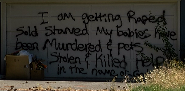 The message on a garage door in Grants Pass was spray painted by the owner and resident. (KTVL/Mike Marut)