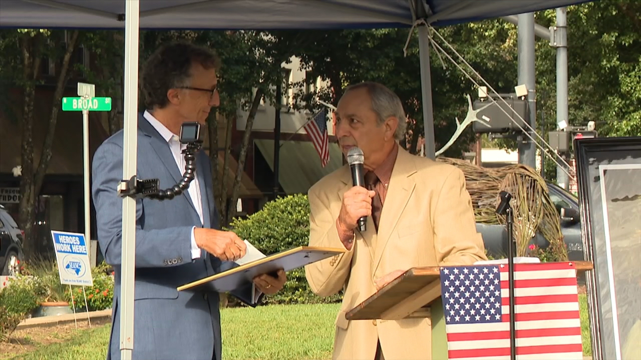 The Veterans History Museum of the Carolinas presented the Transylvania County Honor Guard, the Brevard American Legion Post, the Veterans of Foreign Wars post and the Blue Ridge Honor Flight with checks from the Toni Lee Casciato Memorial Fund. (Photo credit: WLOS staff)
