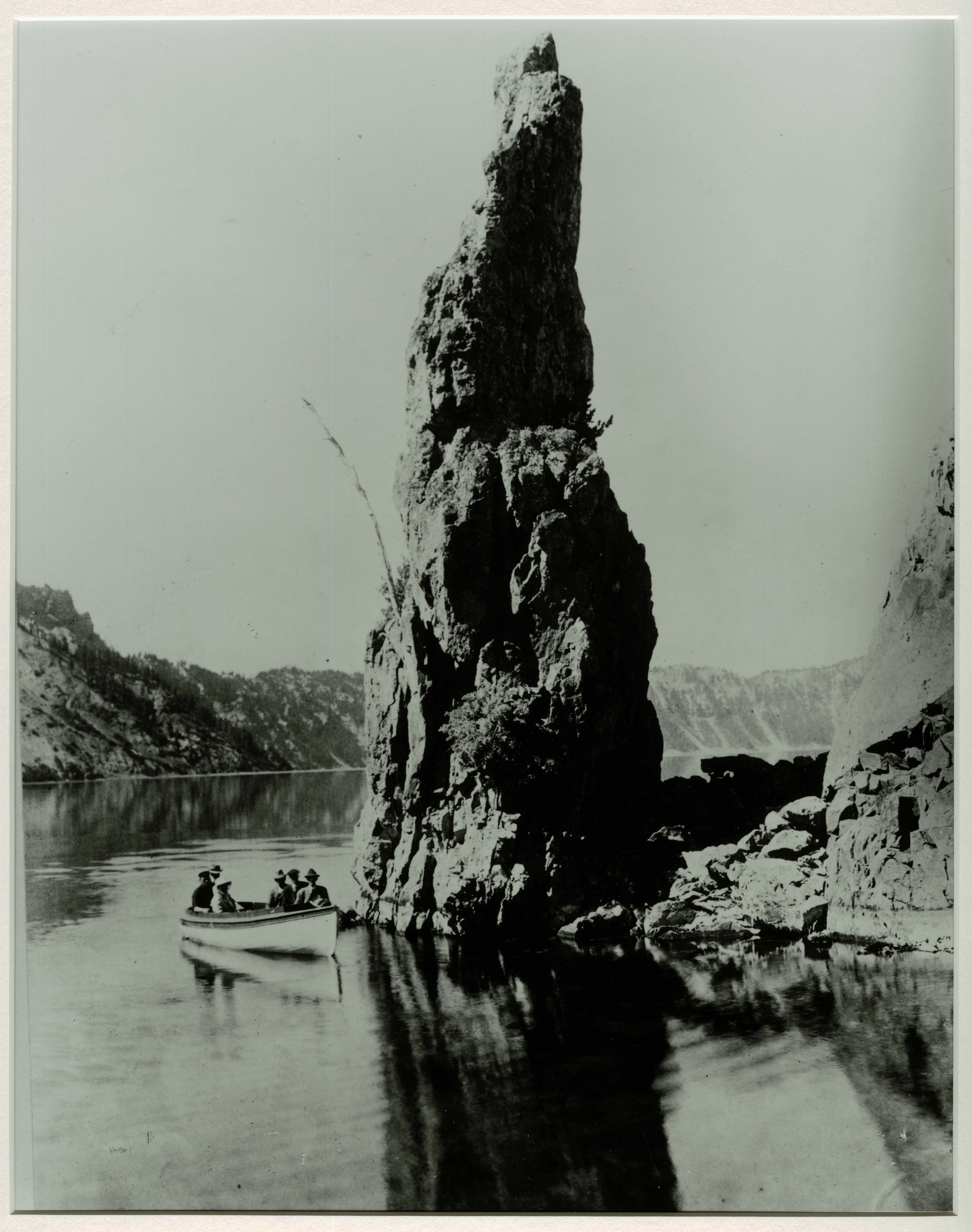 Boat tours rounding a portion of Pantom Ship. Photographed by J.S. Diller in the 1890s or 1901 during the USGS survey of the Crater Lake area.   Credit: Courtesy CRLA Museum & Archive Collections