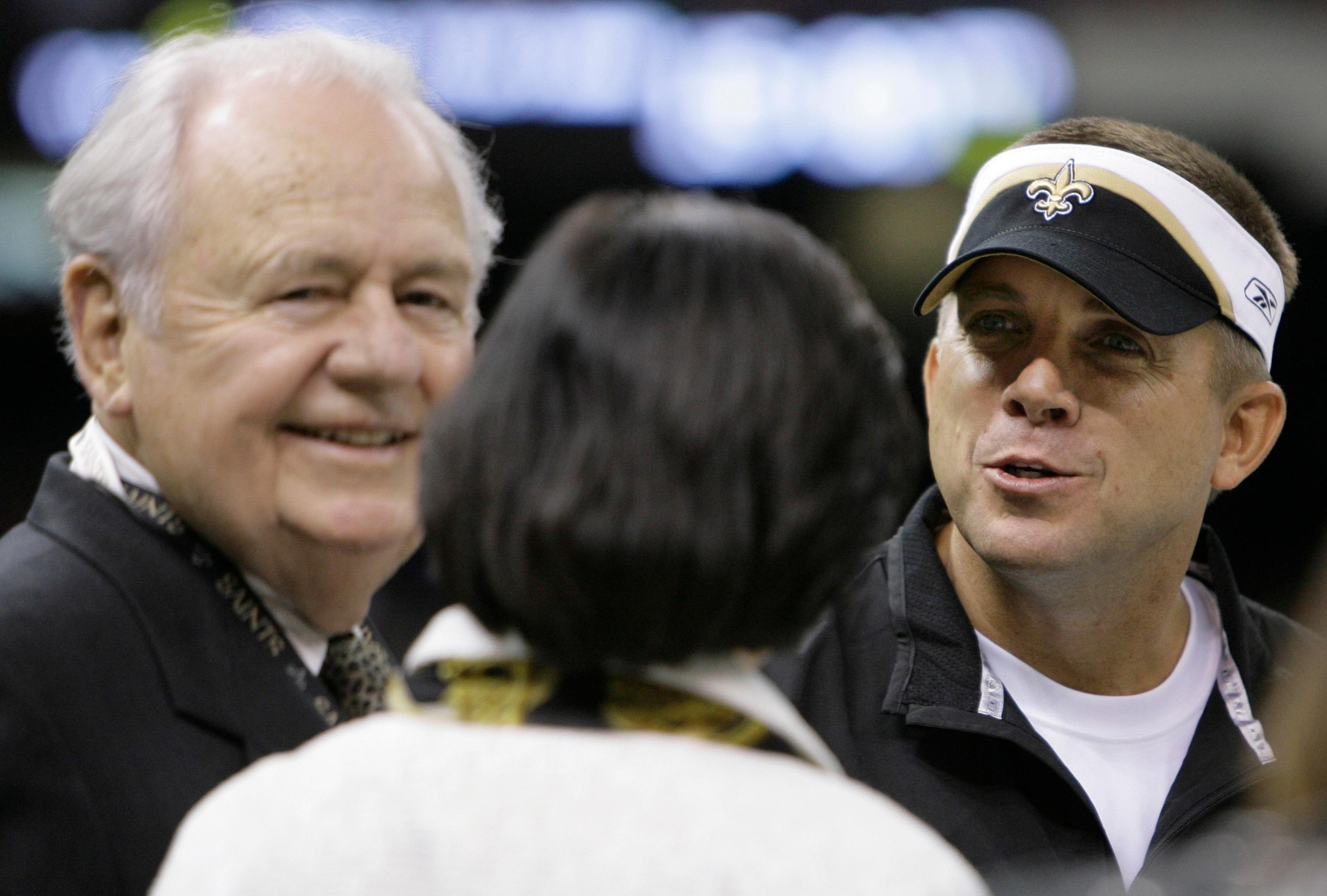 "File-This Aug. 30, 2007, file photo shows New Orleans Saints owner Tom Benson left, and his wife Gayle Benson talking with coach Sean Payton before their pre-season football game in New Orleans.  Benson, a successful auto dealer who brought the New Orleans Saints their only winning seasons and the ""Benson Boogie,"" has died. Benson, who has also owned the NBA's New Orleans Pelicans since 2012, was 90. The NFL and NBA teams announced Benson's death on Thursday,  March 15, 2018. (AP Photo/Alex Brandon)"