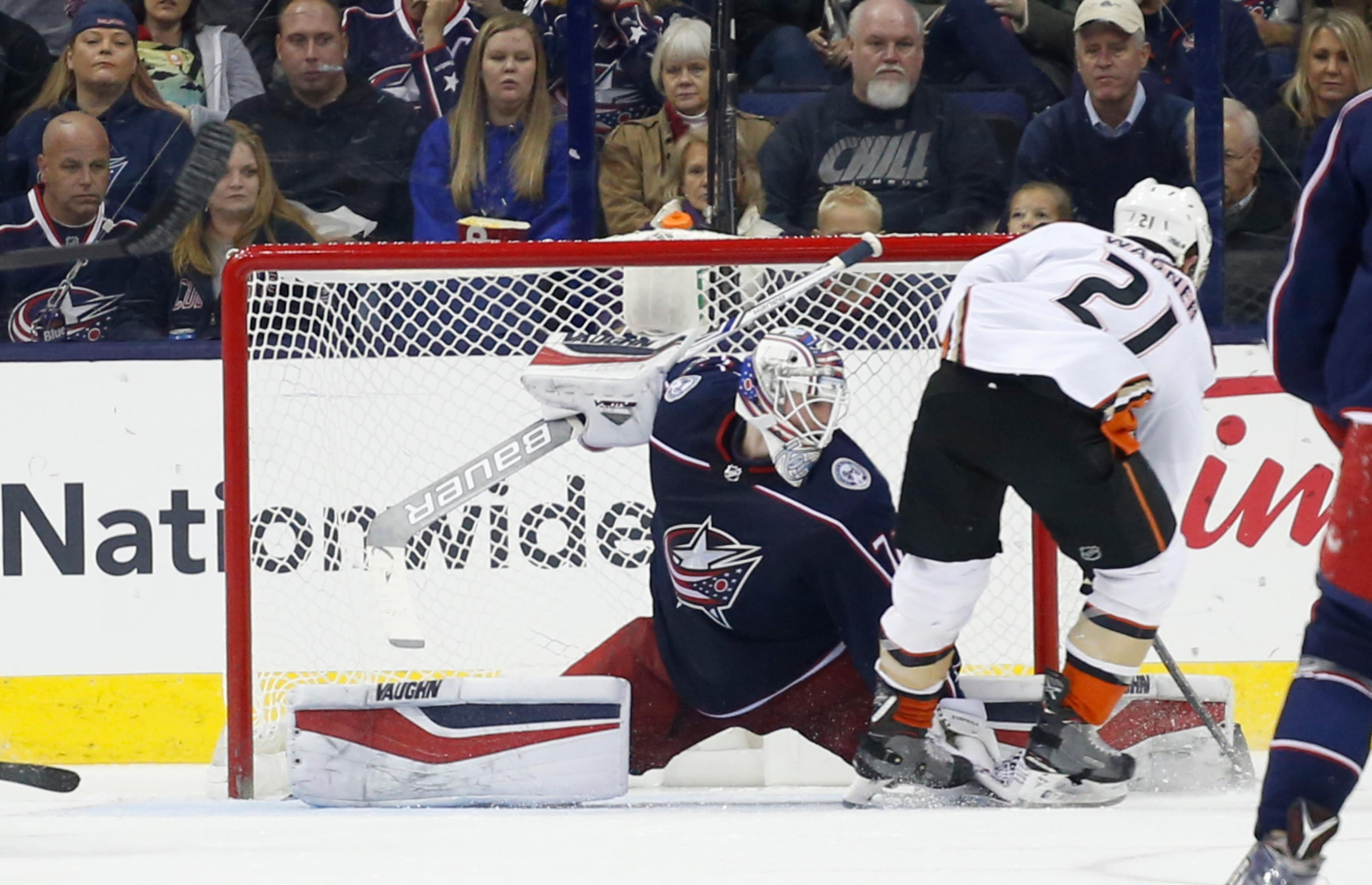 Columbus Blue Jackets' Joonas Korpisalo, left, of Finland, makes a save against Anaheim Ducks' Chris Wagner during the second period of an NHL hockey game Friday, Dec. 1, 2017, in Columbus, Ohio. (AP Photo/Jay LaPrete)