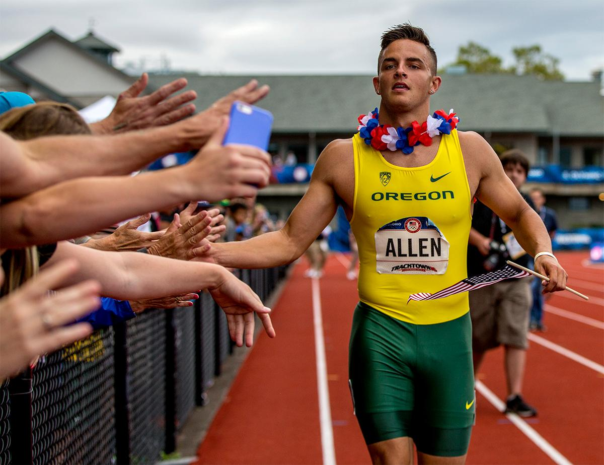 OregonÃ?s Devon Allen high fives fans as he takes his victory lap after winning the 110 meter hurdles in 13.03. Photo by August Frank, Oregon News Lab