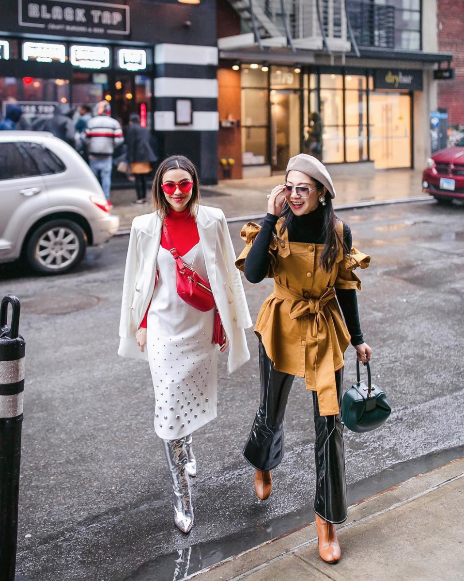 What's better than dressing up with friends? D.C.'s own Holly of Petite Flower Presents did it up with fellow fashion blogger Lavenda on the streets for NYFW. (Image via @petiteflowerpresents, photo by @justdontstall)<p></p>