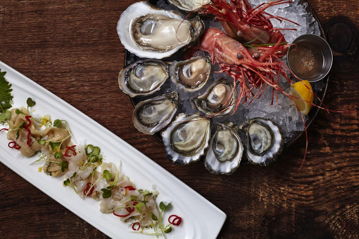 Taylor Shellfish's Shiso Geoduck sourced from the south sound and is sliced two ways with shiso oil, kaiware sprouts, lemon zest, red pepper and sea salt. (Photo: Courtesy Taylor Shellfish)