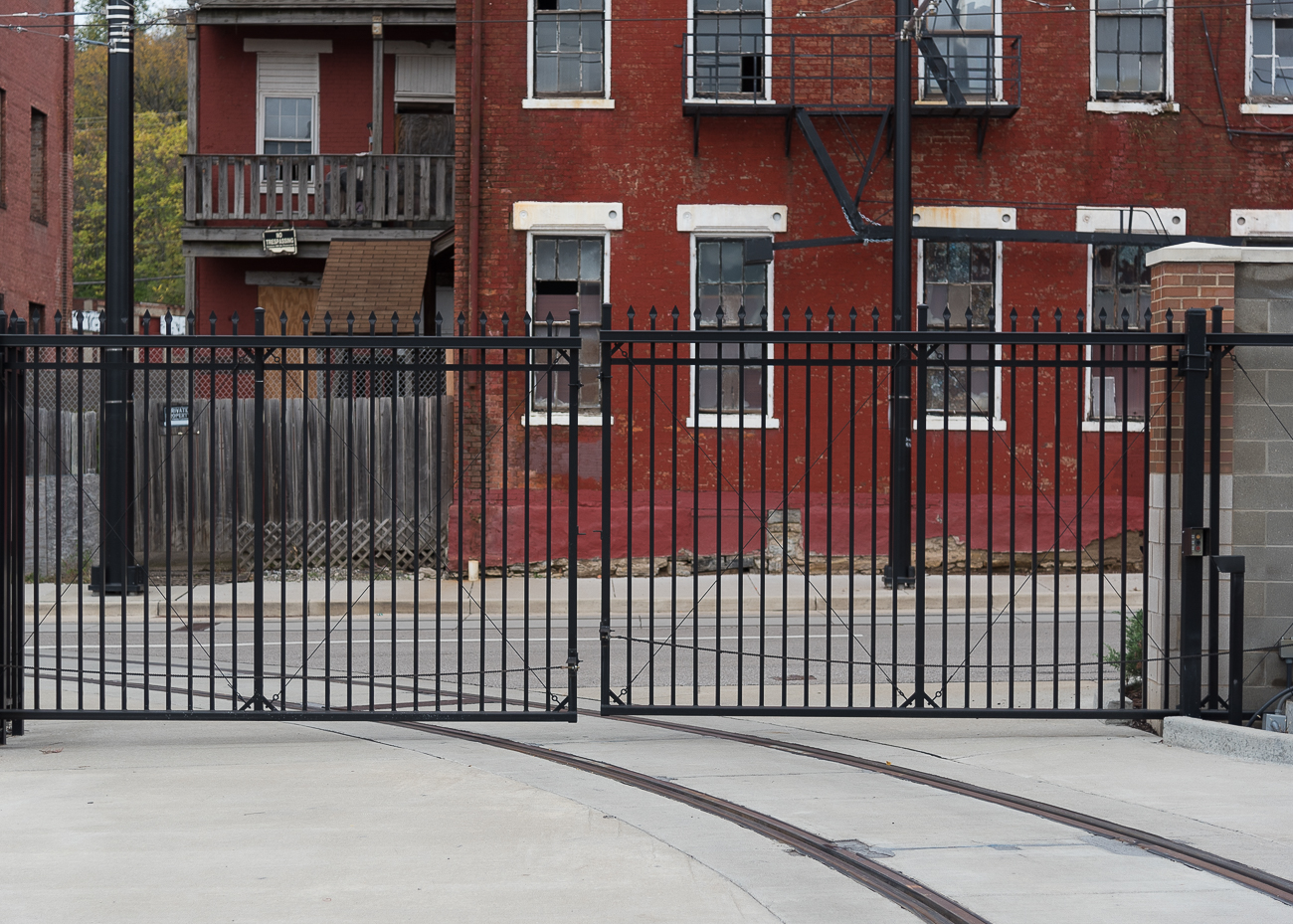 Streetcars enter through a security gate located on Henry Street to the north of the MOF. / Image: Phil Armstrong, Cincinnati Refined // Published: 11.13.17<p></p>