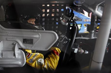 Josh Wise puts on his gloves as he prepares for practice for Sunday's Aaron's 499 NASCAR auto race at Talladega Superspeedway on Friday, May 2, 2014, in Talladega, Ala.