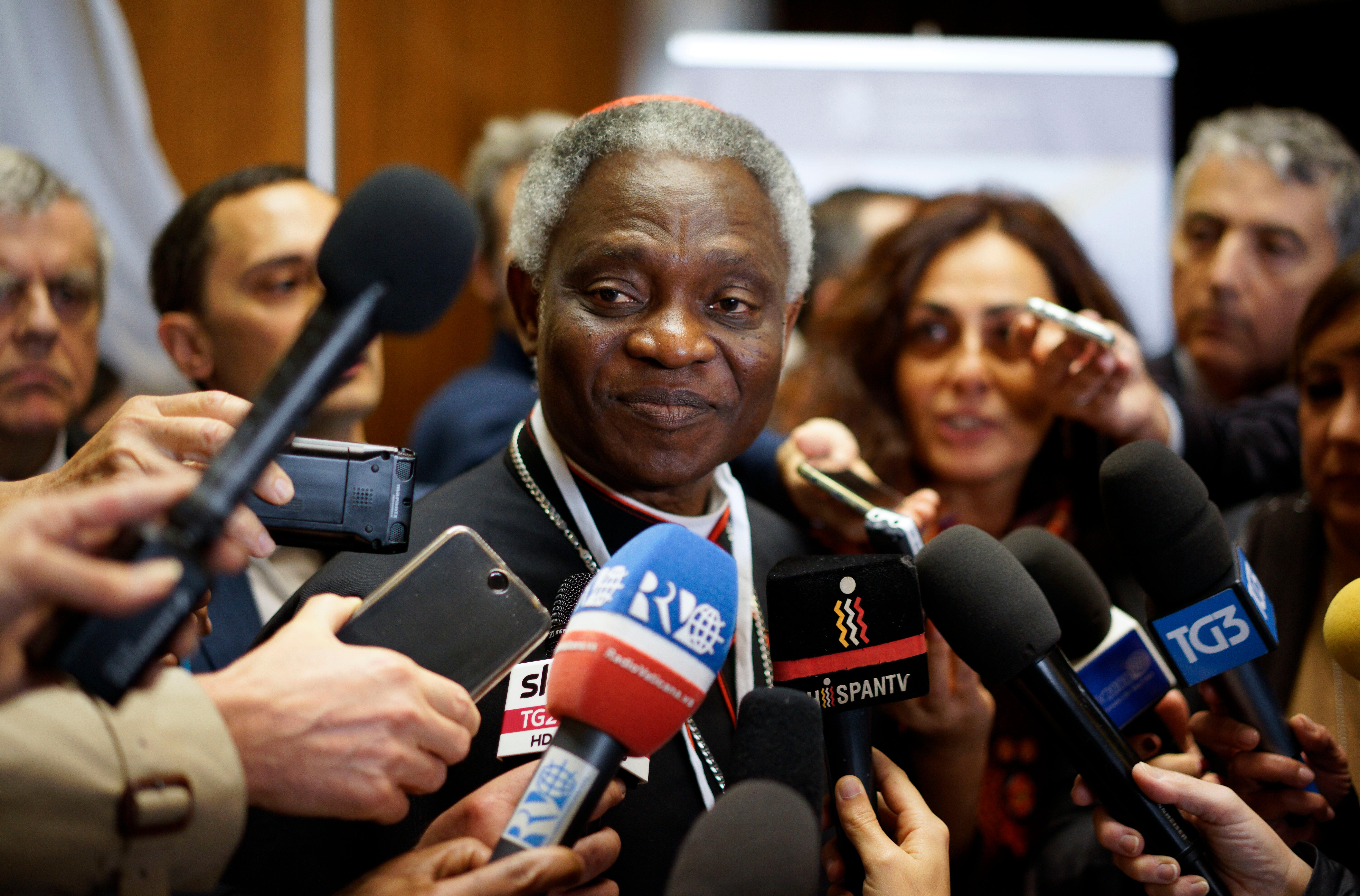 Cardinal Peter Kodwo Appiah Turkson to reporters during a break of a conference on nuclear disarmament, at the Vatican, Friday, Nov. 10, 2017. The Vatican hosted Nobel laureates, U.N. and NATO officials and a handful of nuclear powers at a conference aimed at galvanizing support for a global shift from the Cold War era policy of nuclear deterrence to one of total nuclear disarmament.(AP Photo/Andrew Medichini3