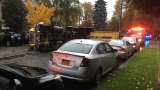 Dump truck overturns in Seattle neighborhood, blocks street