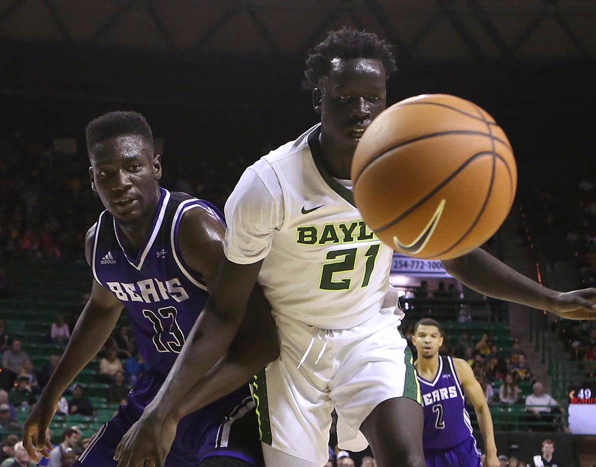Baylor forward Nuni Omot (21) and Central Arkansas forward Otas Iyekekpolor (13) watch as the loose ball goes out of bounds in the second half of a NCAA college basketball game, Friday, Nov. 10, 2017, in Waco, Tx. Baylor won 107-66. (AP Photo/Jerry Larson)