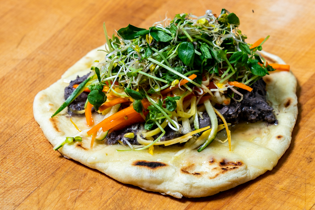 Pita Piper: spicy black bean hummus, Havarti cheese, julienne veggies, and sprouts on a fresh pita / Image: Amy Elisabeth Spasoff // Published: 9.29.18