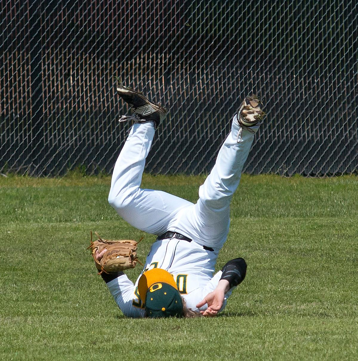 Oregon Djucks center fielder Logan Ballarche makes a diving catch. The Oregon Ducks won the Civil War series this weekend against the Oregon State Beavers. The Ducks won the first game 13-3, but lost the second game 12-0, then rebounding to win the third and deciding game 4-3. The Ducks Club baseball team finished the season with a league record of 14-1, taking first place. They now move on to the Regionals in Boise, Idaho, in two weeks. The Club team won the National Championship in 2015 and came in third nationally in 2016. Photo by Dan Morrison, Oregon News Lab