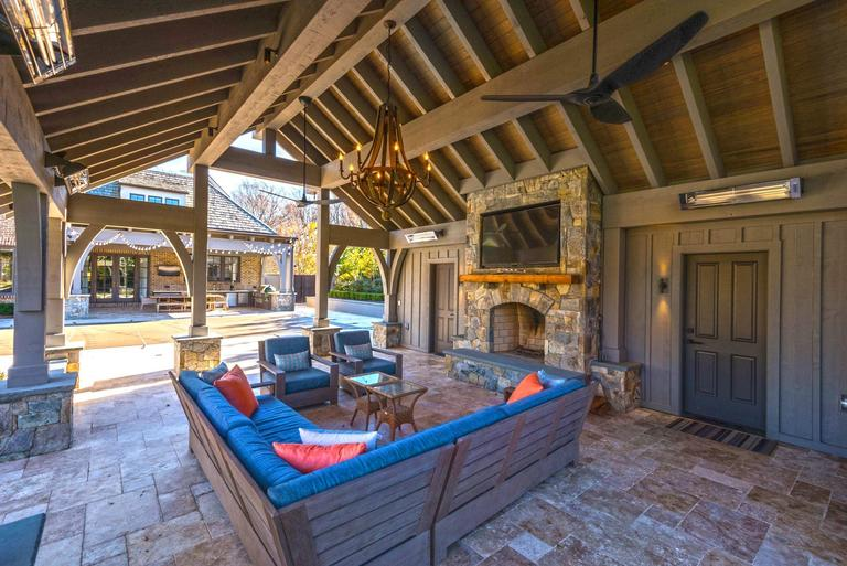 He also added a pool pavilion with a gas fireplace and lots of seating, great for summertime entertaining. (Image: Courtesy HomeVisit)<p></p>