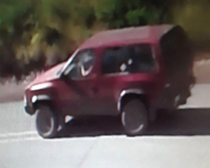 The suspects were seen leaving in an older red SUV. (Jackson County Sheriff's Office)