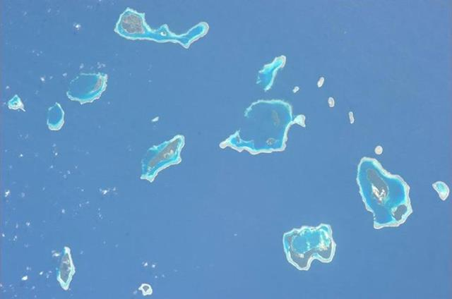 Beautiful islands in Pacific after passing New Zealand. I love the range of blue/green colors in the water. (Photo & Caption: Mike Hopkins, NASA)