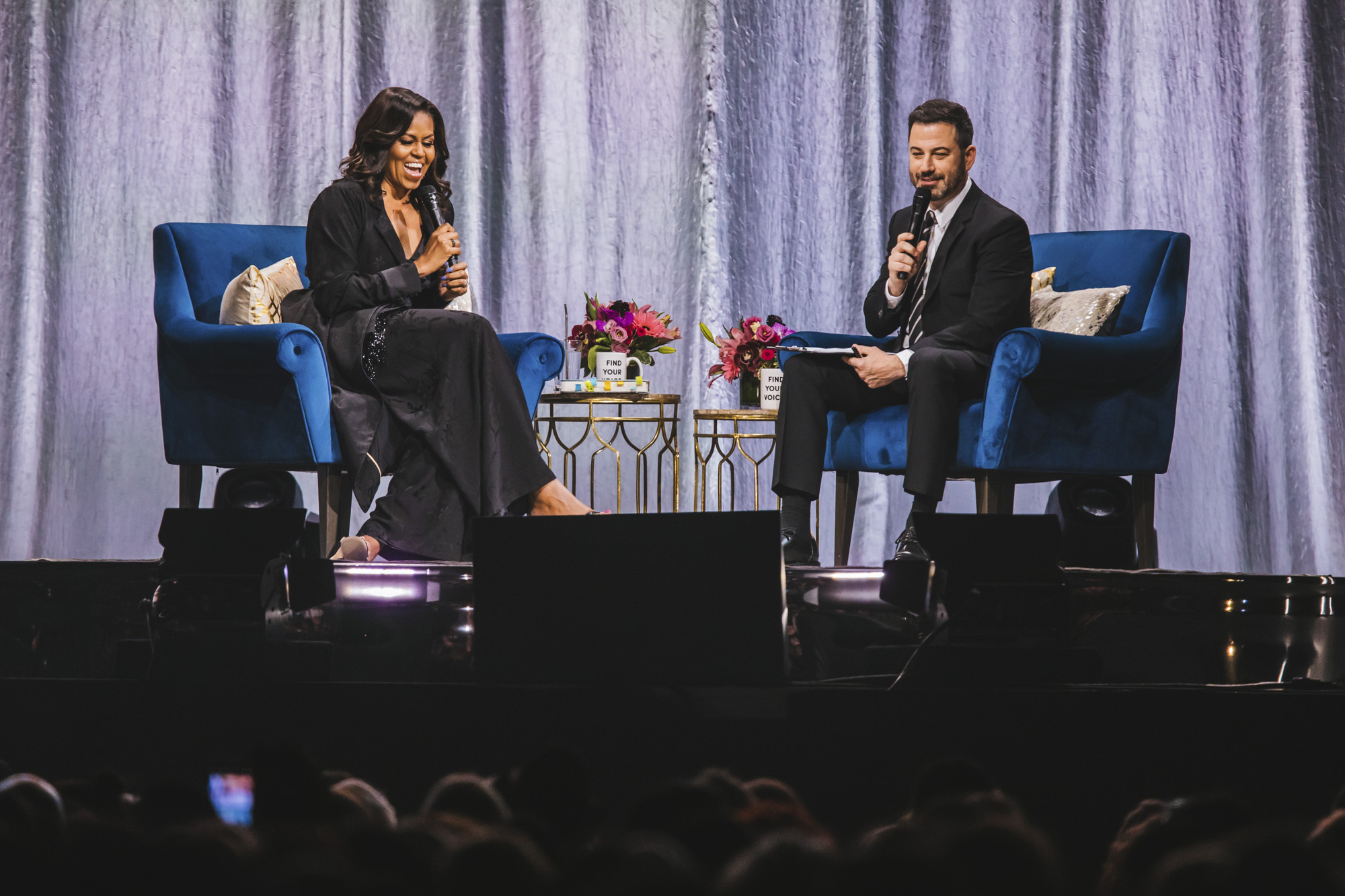 "Michelle Obama stopped by Tacoma on her ""Becoming"" book tour, to the largest crowd she'd seen so far on the tour. The former first lady spoke for about two hours to an absolutely packed crowd, with an intro from Ciara and moderated by Jimmy Kimmel. (Image: Sunita Martini / Seattle Refined)"