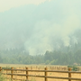 Crews battle the Flounce Fire as it doubles in size
