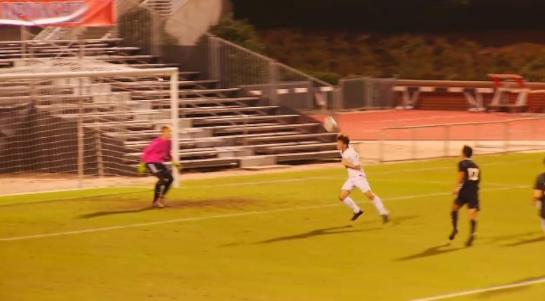 The Rockets' Matthew Kennedy attempts a header in the first half (WLOS Staff).jpg