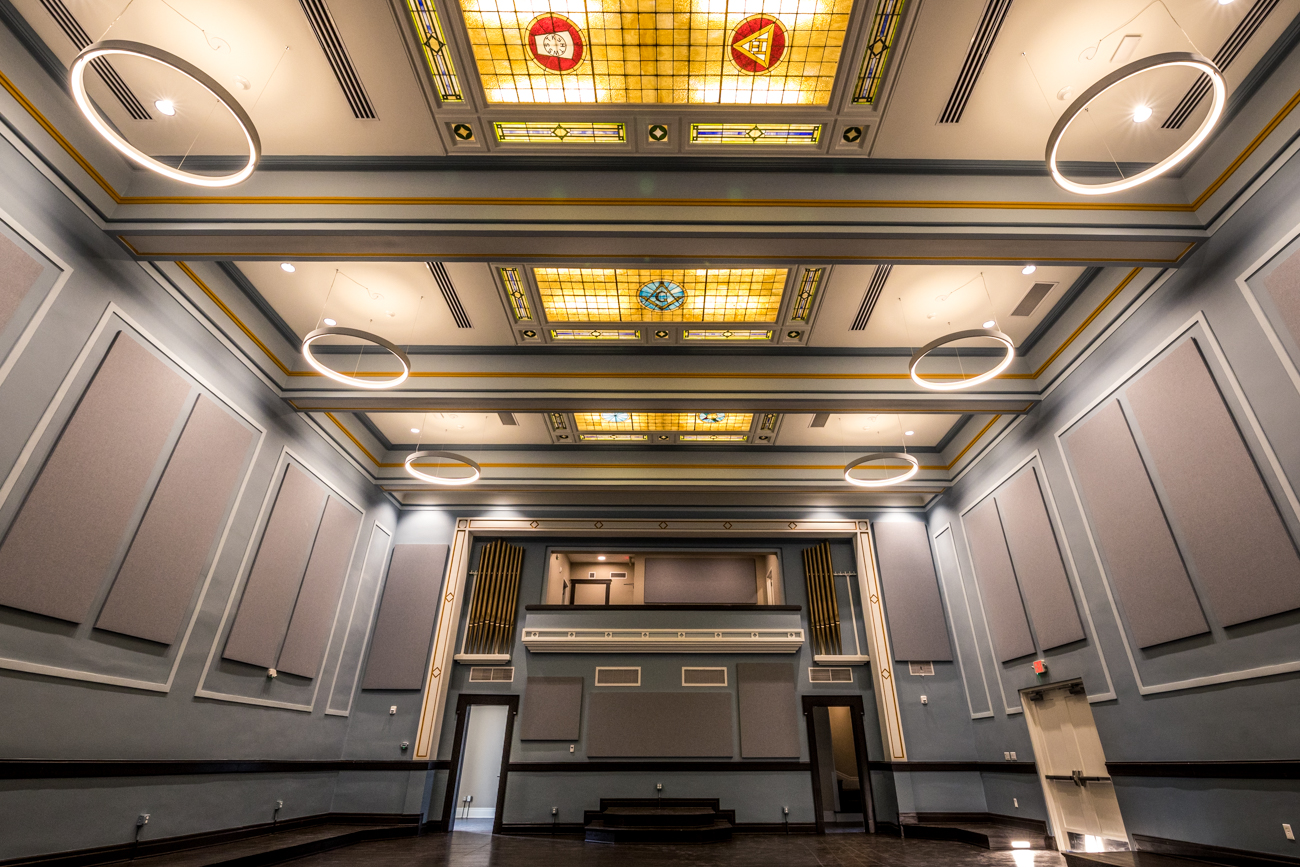 The Myaamia Ballroom features restored hard pine flooring that was scavenged from throughout the building. The platform areas and stained-glass ceiling panels are original. The Masons would have used the room for ceremonies. / Image: Catherine Viox // Published: 10.30.20